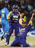 Was this a decisive moment? Tillakaratne Dilshan celebrates his spectacular catch of Rahul Dravid in the Asia Cup final  © AFP